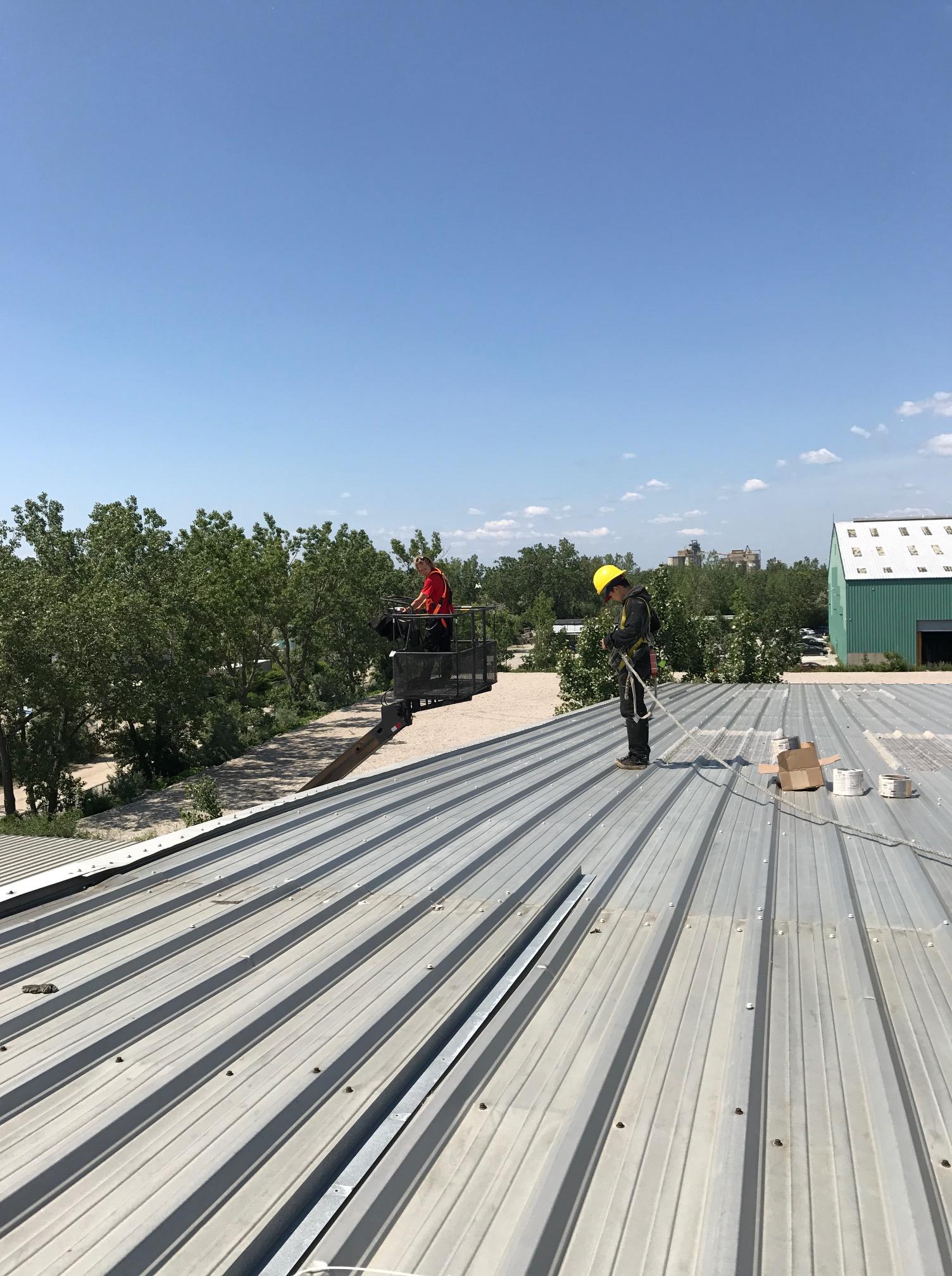 Repairs to metal roof on film set of Star Trek series