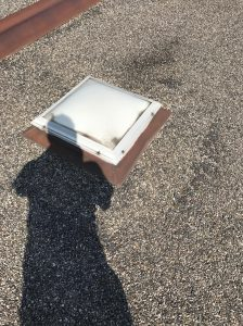 Skylight in built up roof system on flat in Toronto