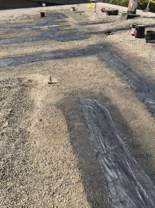 Cold tar repairs to tar and gravel roof in Etobicoke