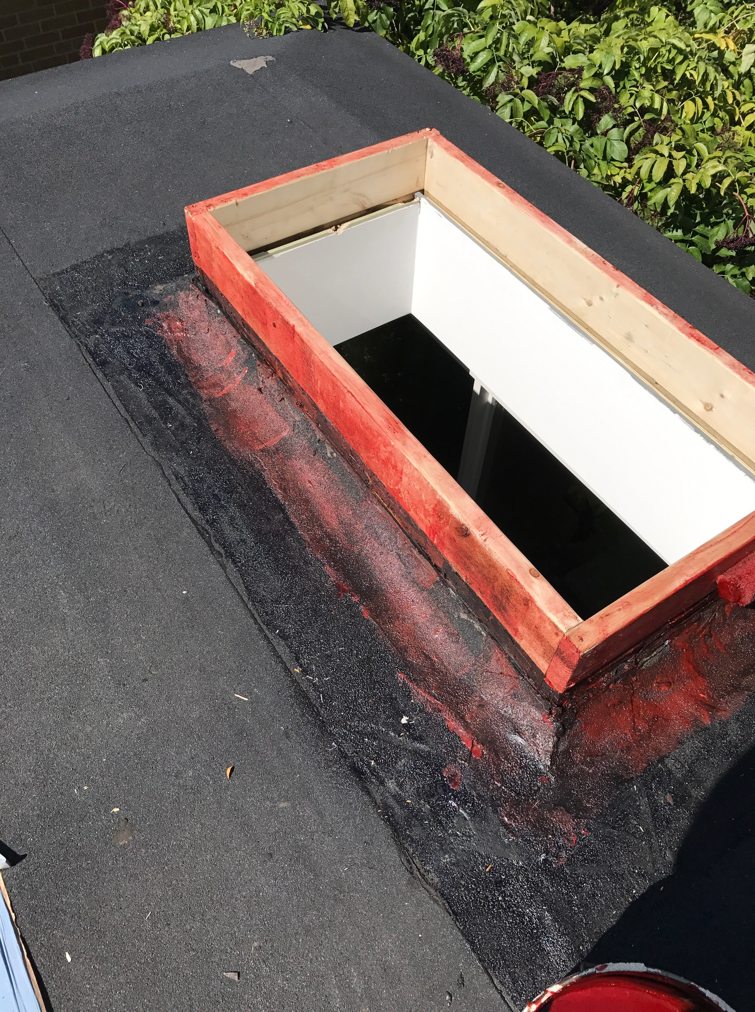 Peel and stick membrane flashing to skylight on flat roof Toronto