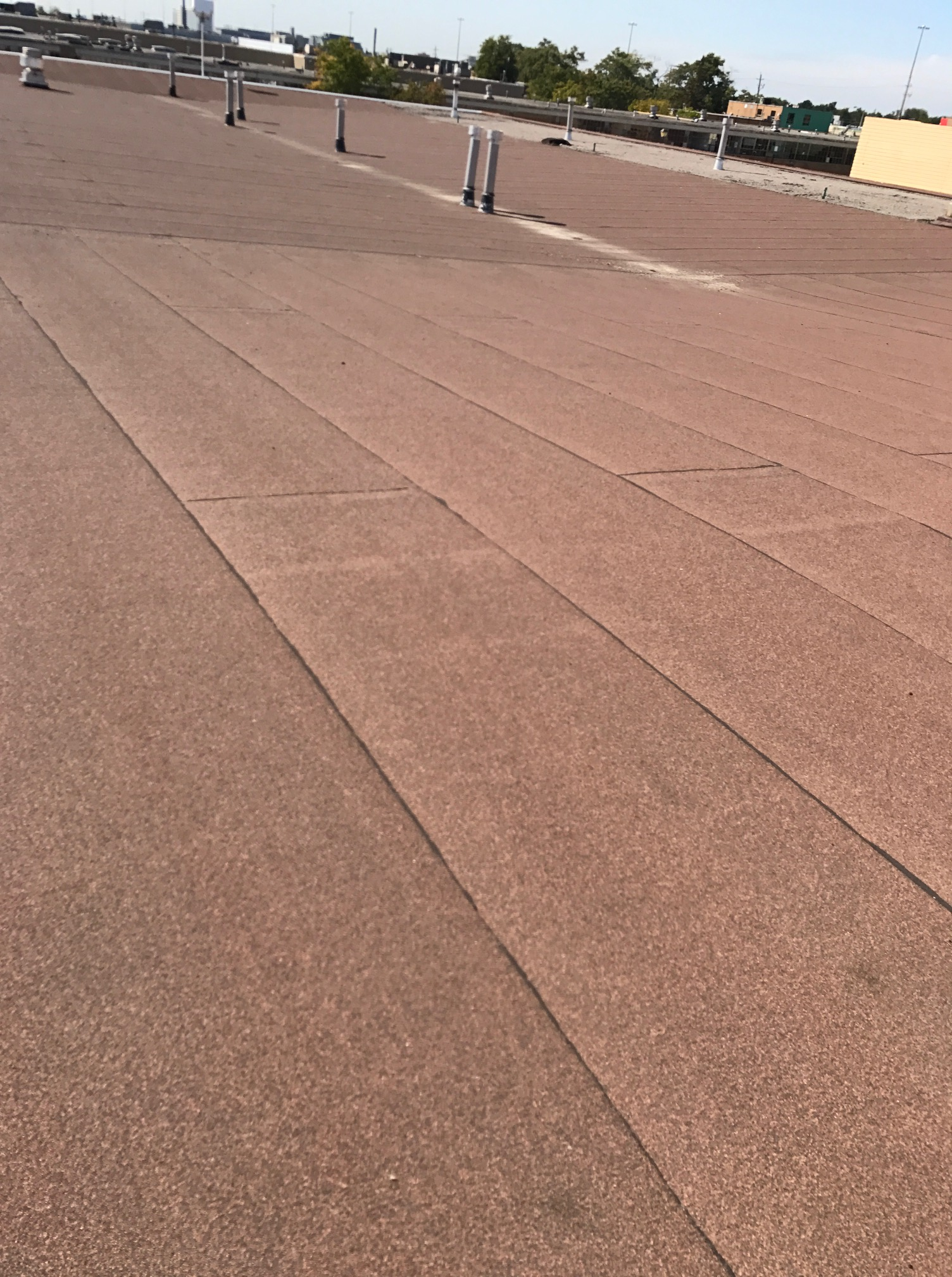 Roof repair on commercial building in Toronto