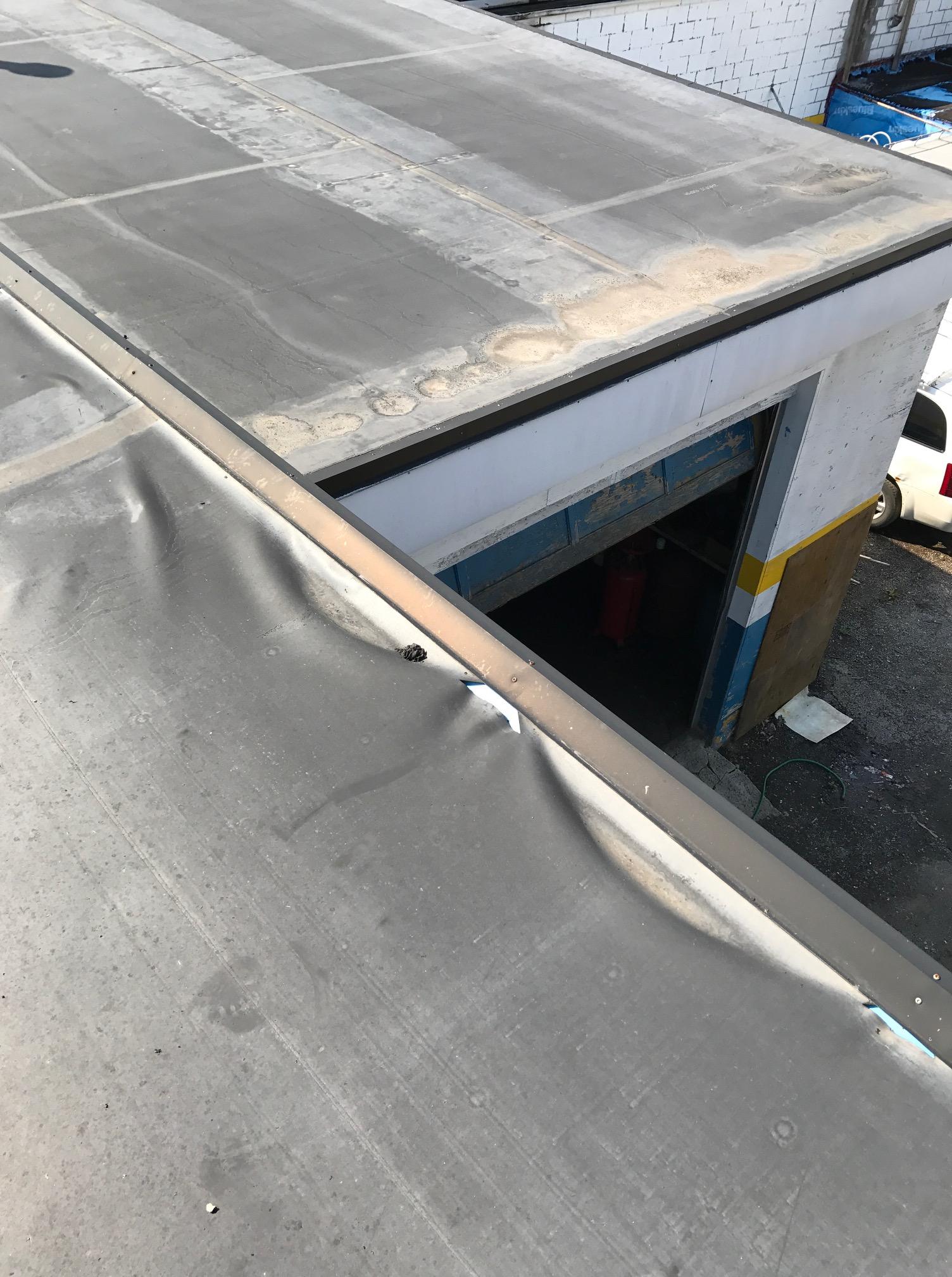 Damaged EPDM membrane commercial building Ajax
