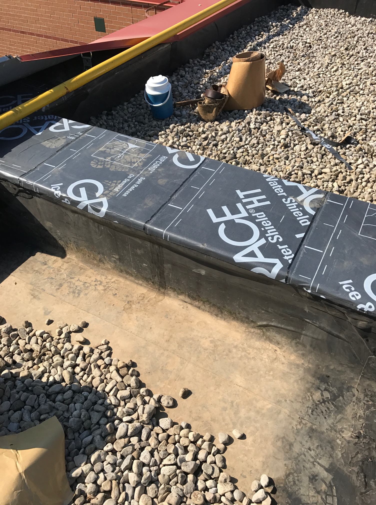 Ice and water shield membrane on flat roof Ajax