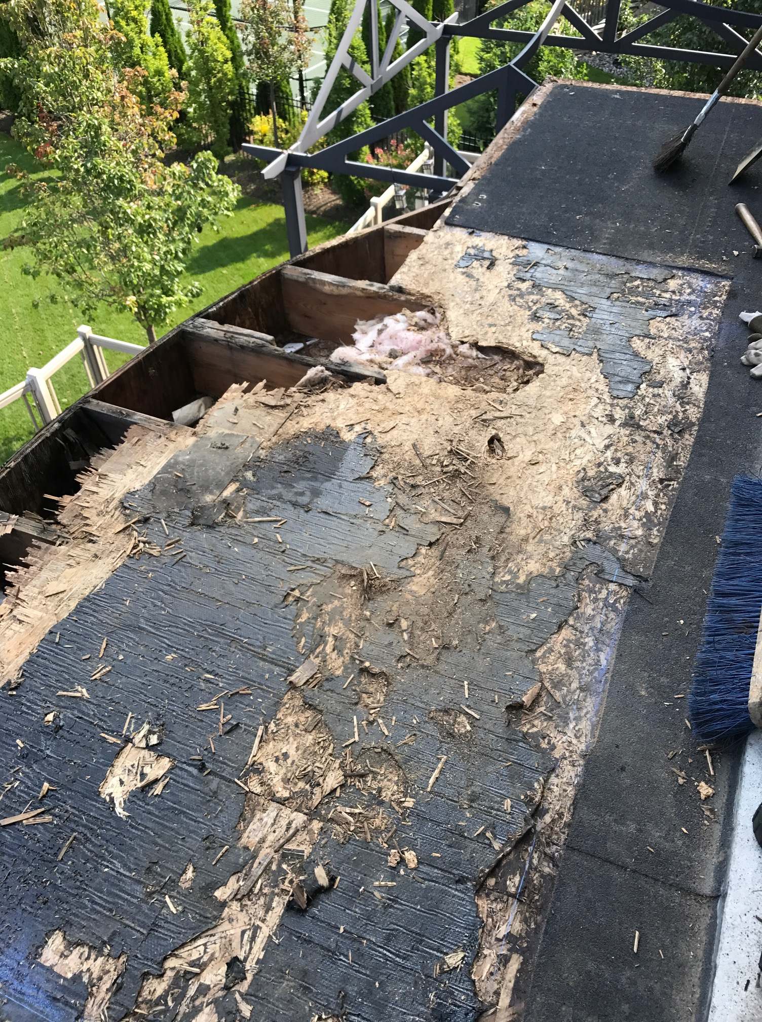 Damaged wood deck flat roof residential Whitby