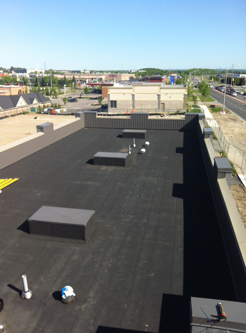 Modified bitumen membrane with sloped insulation Ajax