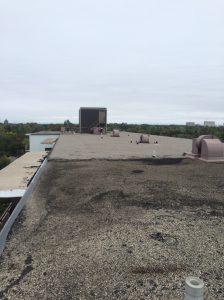 Apartment building flat roof repair