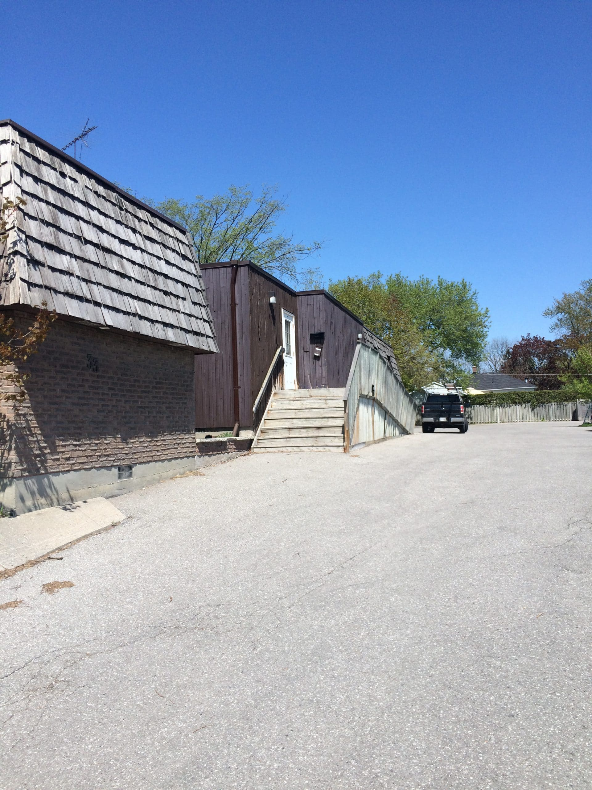 Cedar shingle repair on commercial building in Pickering