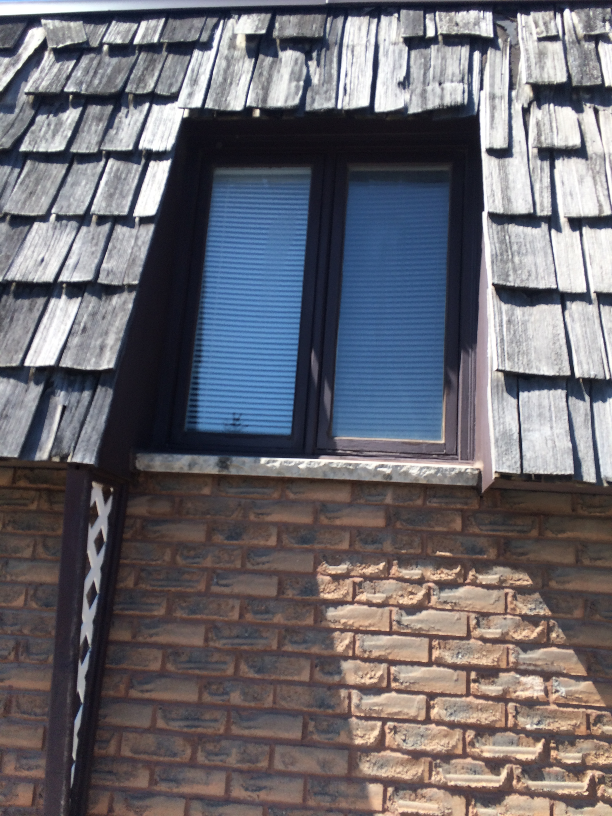 Deteriorated cedar shingles on commercial building in Pickering