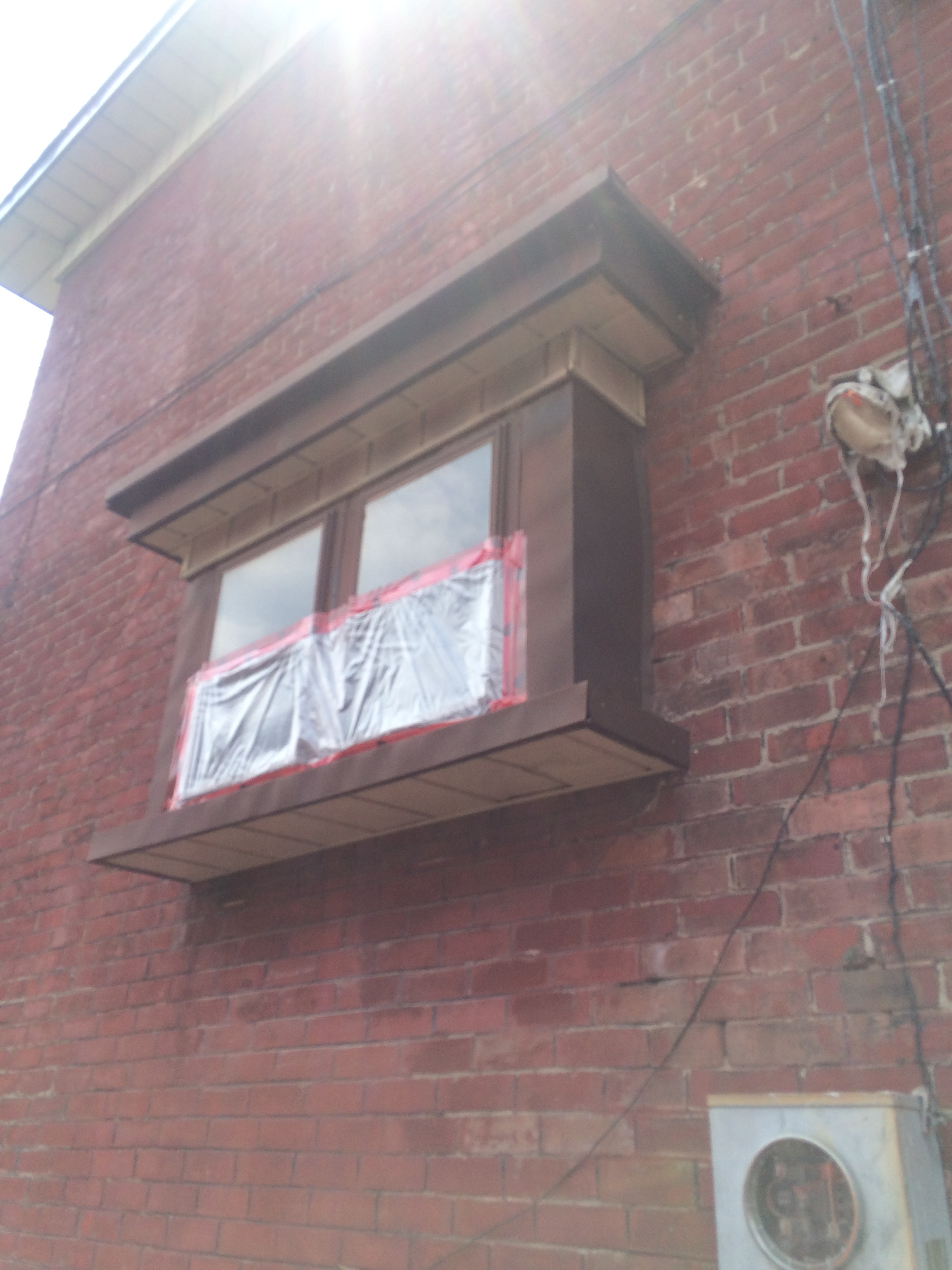 Fire Damage To Bay Window In Toronto Roofing Repair