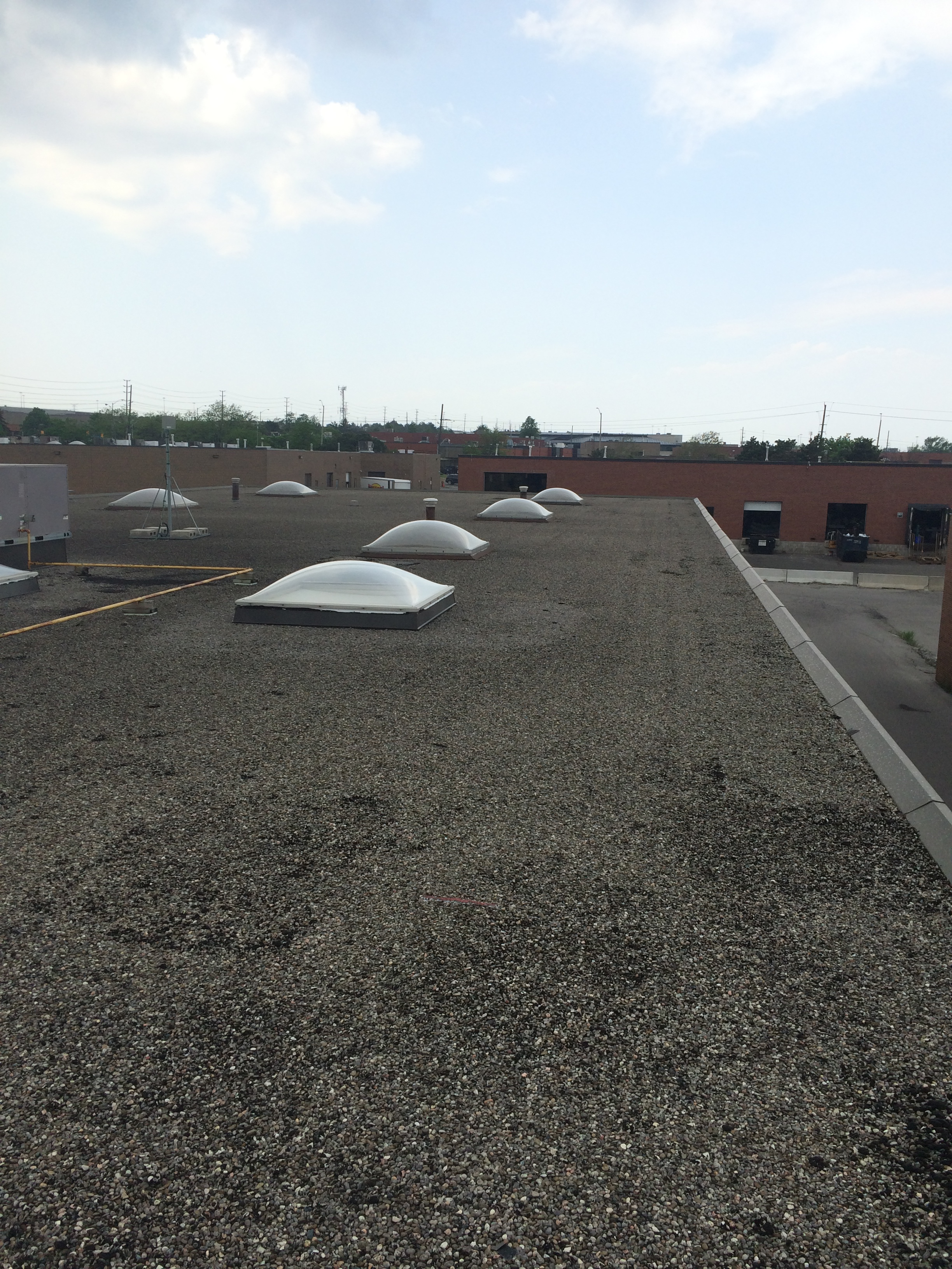 Skylight repairs on commercial building in Mississauga