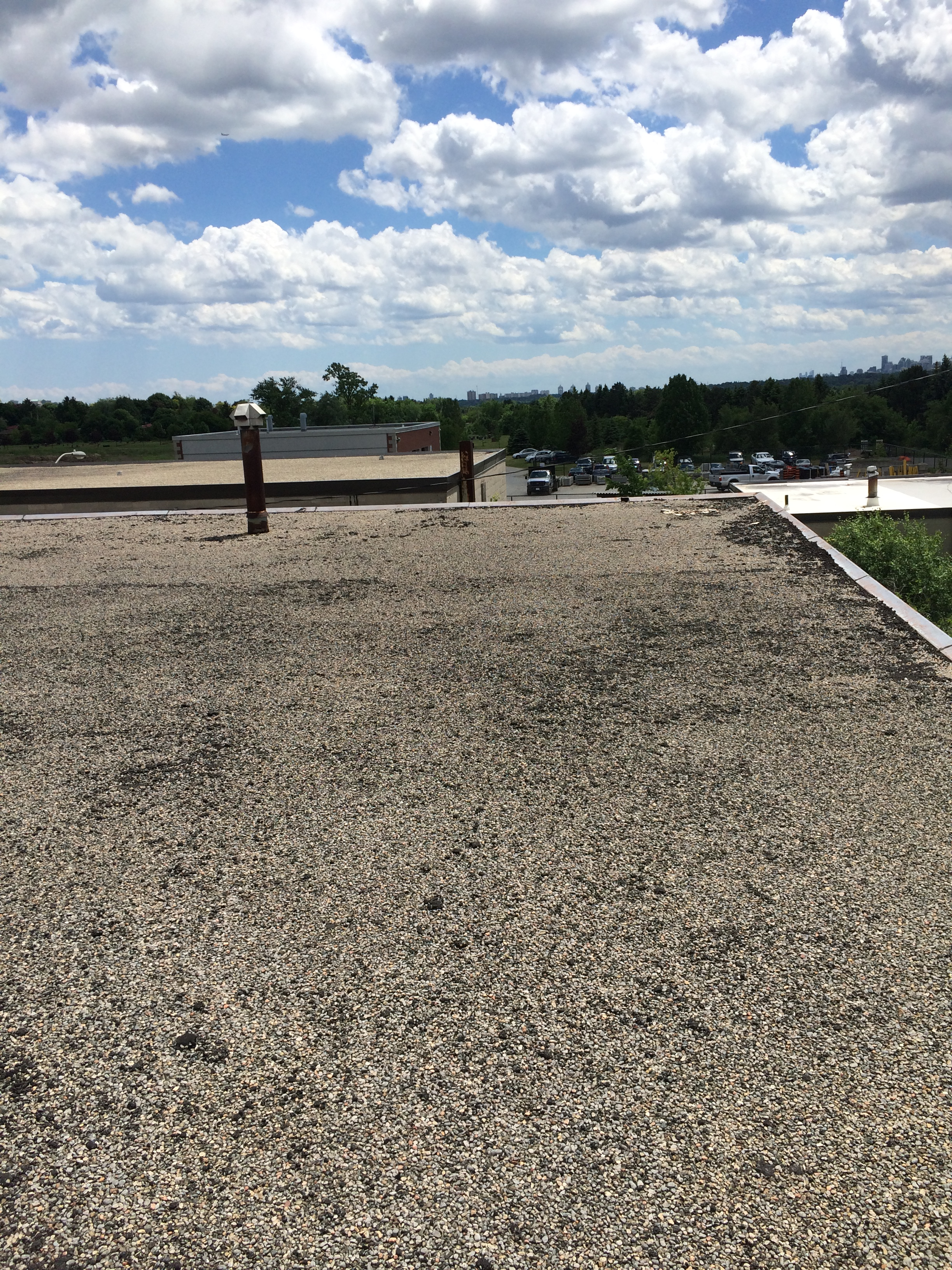 Tar and gravel inspection on flat roof in Markham