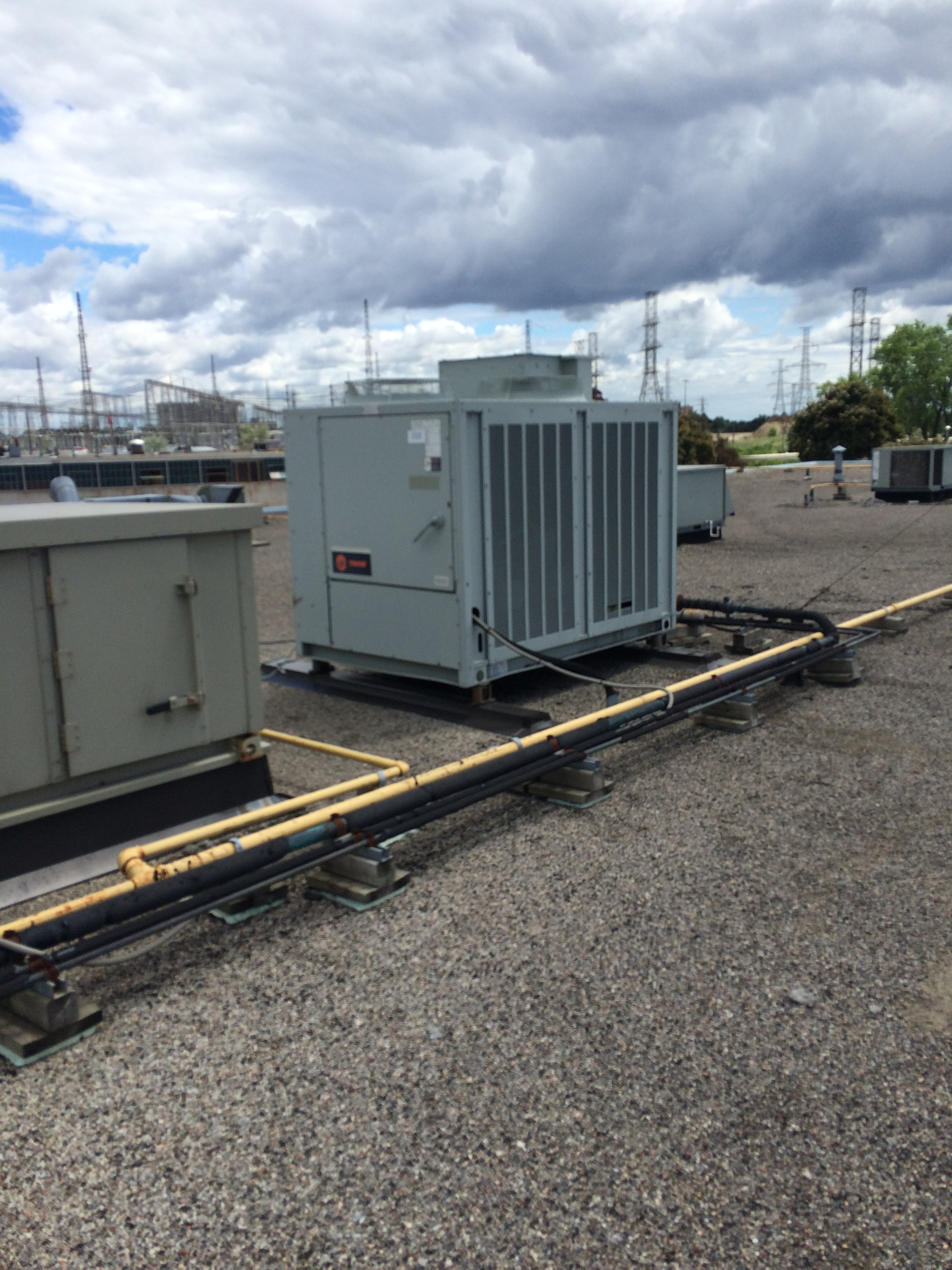 Mechanical units on flat roof in Toronto