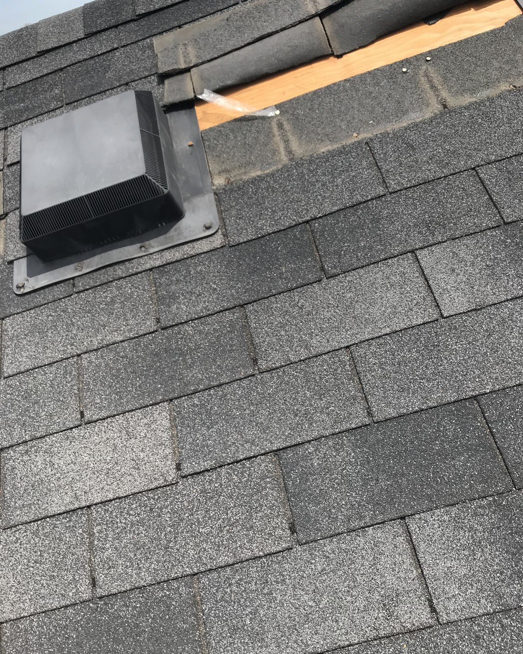 Windstorm damage to shingle roof in Ajax