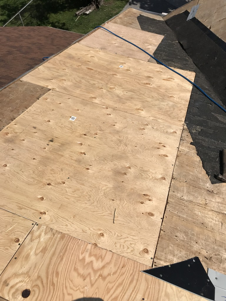 New plywood sheathing to roof in Pickering