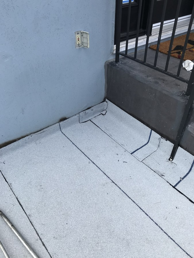 Antirock membrane system on concrete balcony in Toronto