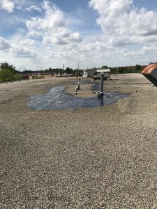 Cold process flat roof repair to commercial building in Markham