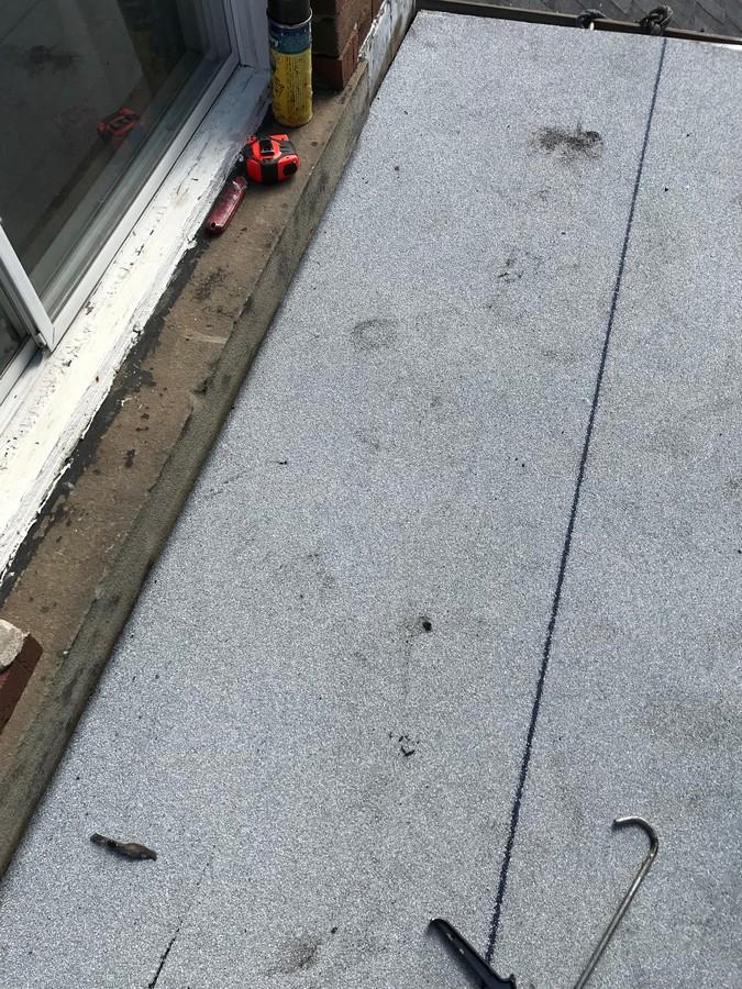 Torch applied membrane on bay window in Toronto