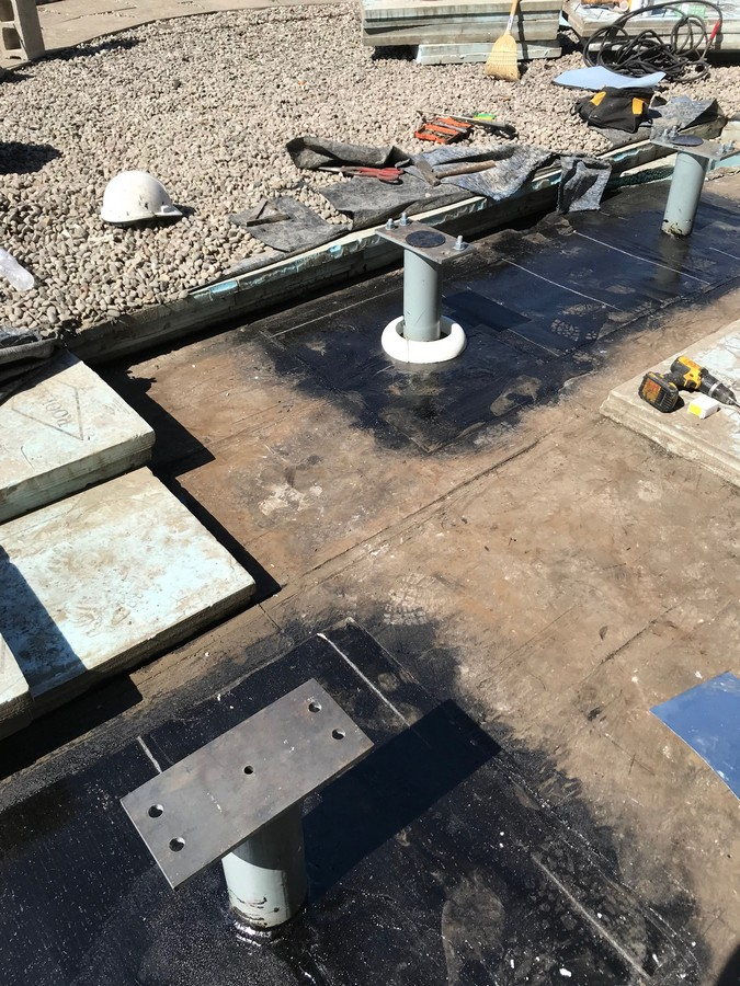 Mechanical fixtures on flat roof deck in Toronto