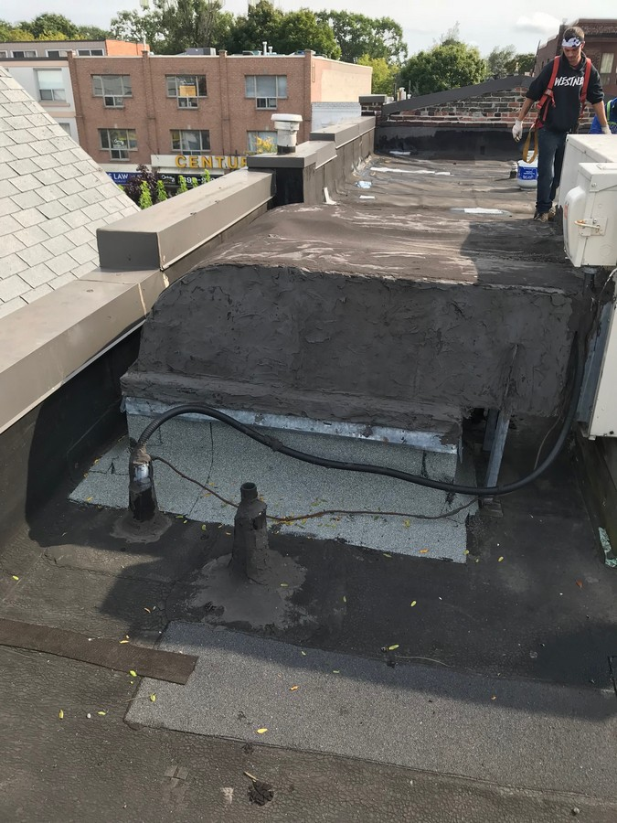 Flat roof repairs at electrical conduit in Toronto