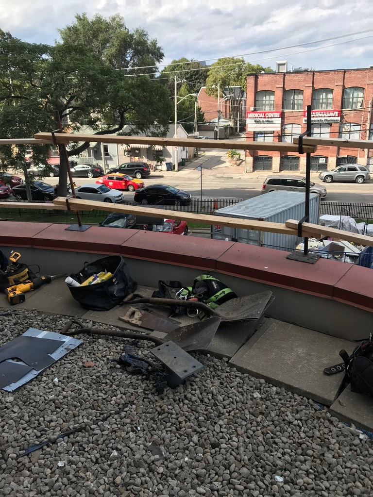Safety rail protection on flat roof in Toronto