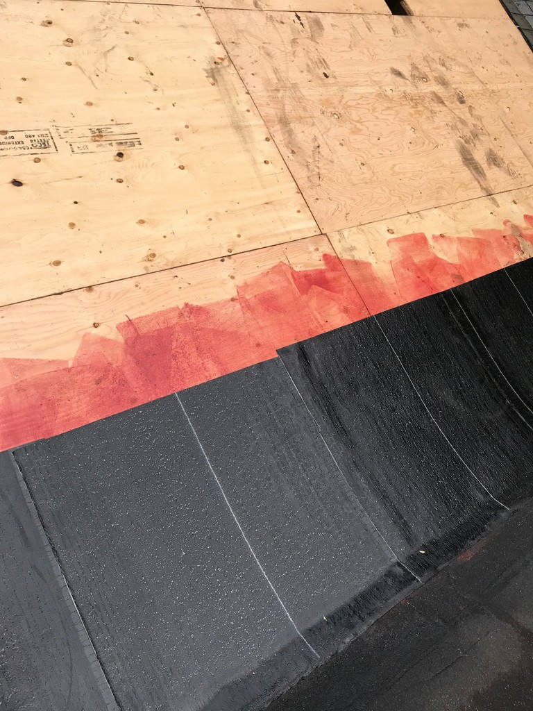 Peel and stick Soprema membrane on flat roof in Toronto