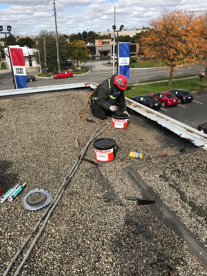 Flat roof inspection of deteriorated membrane roof in Toronto