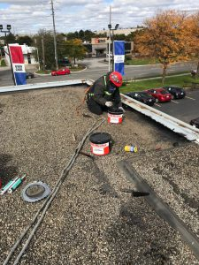 Commercial flat roof repair on car dealership in Burlington