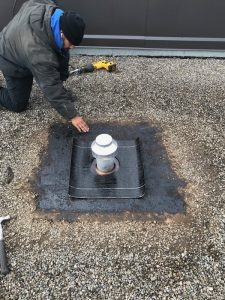 Insulated exhaust vent install on flat roof in Ajax