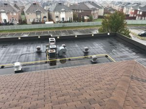 Torch applied membrane roofing system on flat roof in Ajax