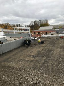Tar and gravel roof repairs on commercial building in Burlington