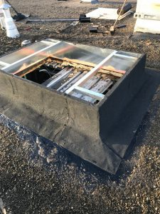 AC curb install with hot asphalt in commercial roof in Scarborough