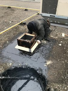 Hot tar roof install of exhaust fan on flat roof in Scarborough