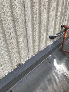 Sheet metal flashing at precast wall on flat roof in Etobicoke