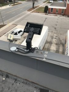 LED light mounted on metal coping on commercial building in Etobicoke