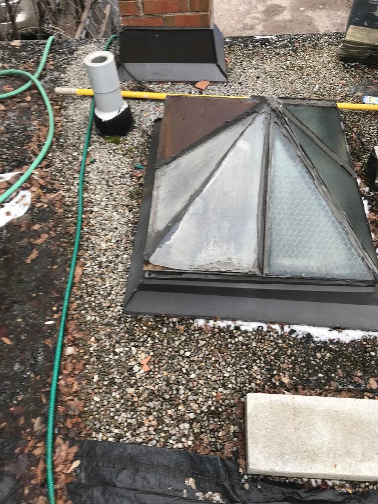 Skylight repair on tar and gravel roof in Toronto