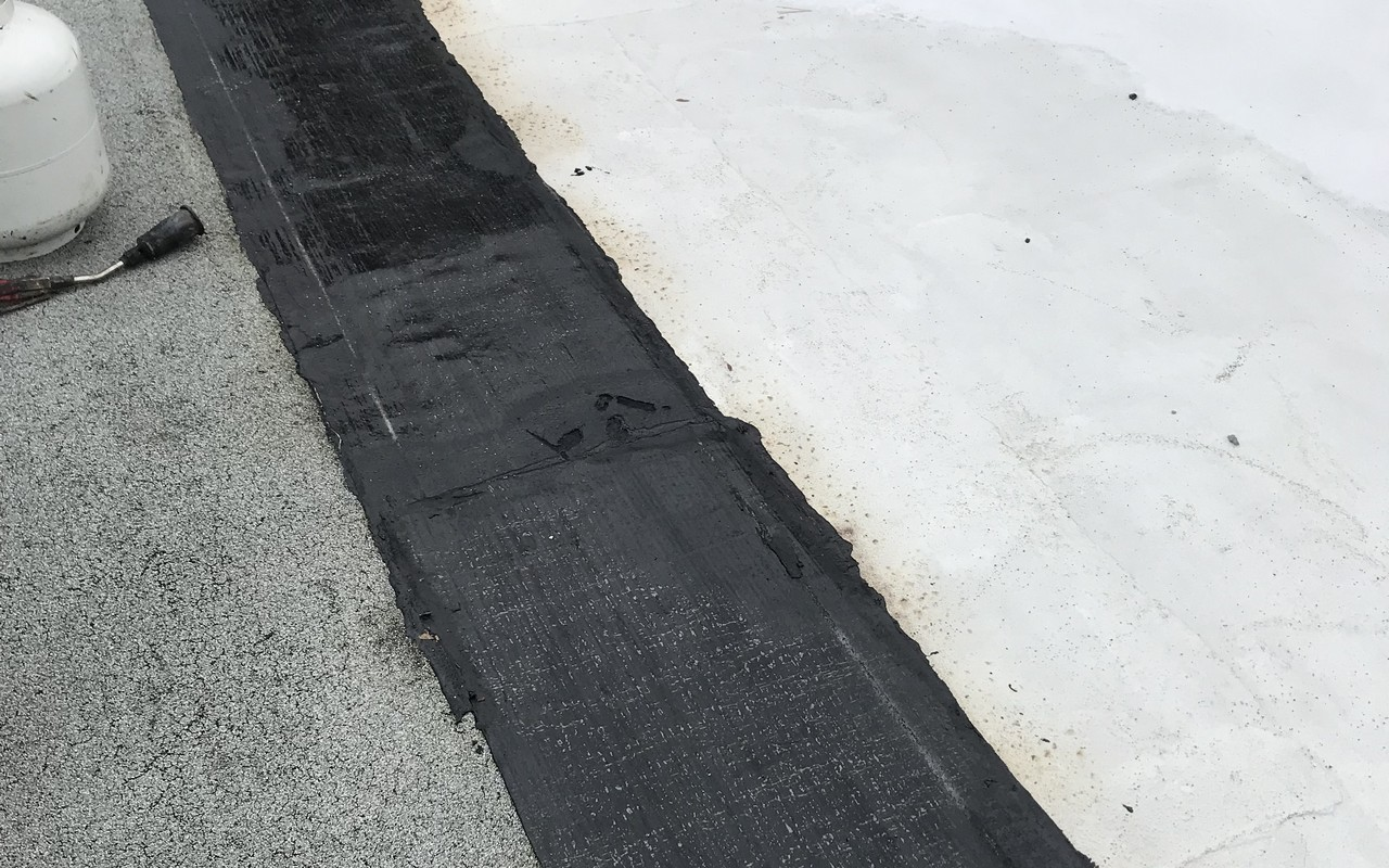Sopralene Flam 180 flashing strips on flat roof in Toronto
