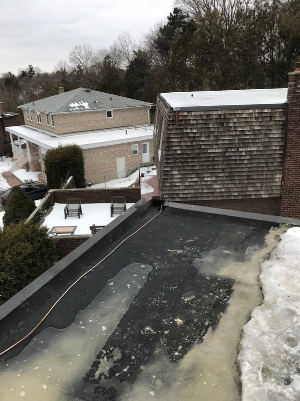 Scupper drain flushed with Sopralene Flam Granules on flat roof in don mills
