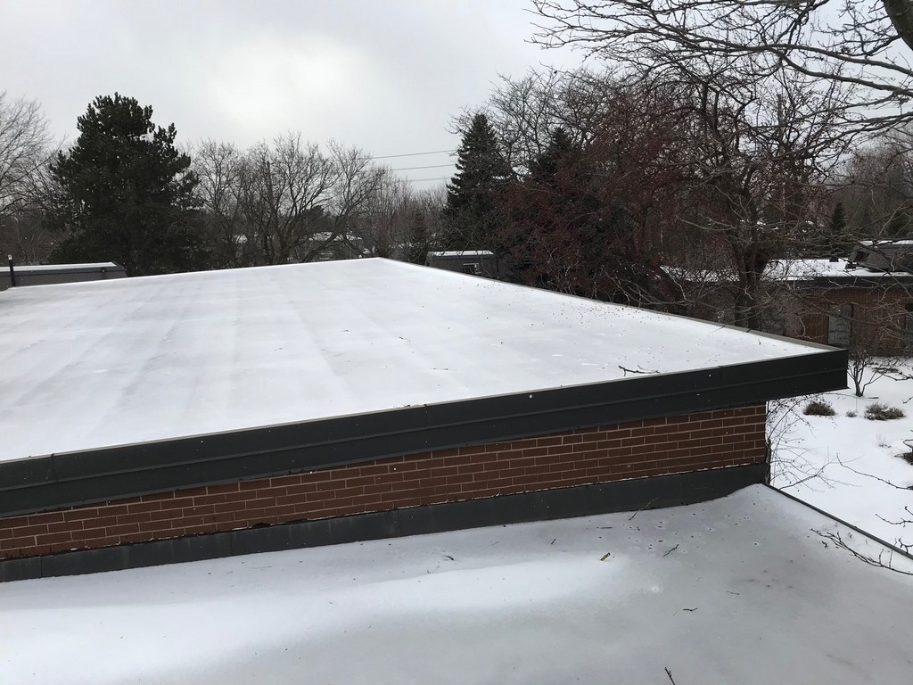 Modified bitumen slopes flat roof on flat roof in Markham