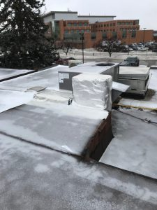 Aluminum foil wrap on flat roof institutional facility in Markham