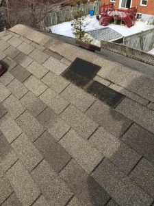 Windstorm damage to asphalt shingles on home in Ajax