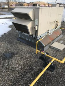 Repairs on commercial building at curb mount AC unit on Scarborough