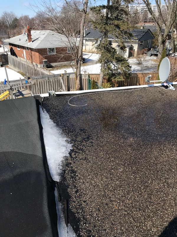 Flat roof repair with roof emulsion coating on garage roof in Scarborough