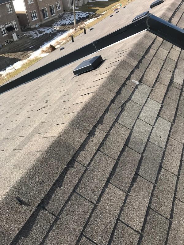 Damaged asphalt 3 tab shingles on townhome in Ajax roof repair