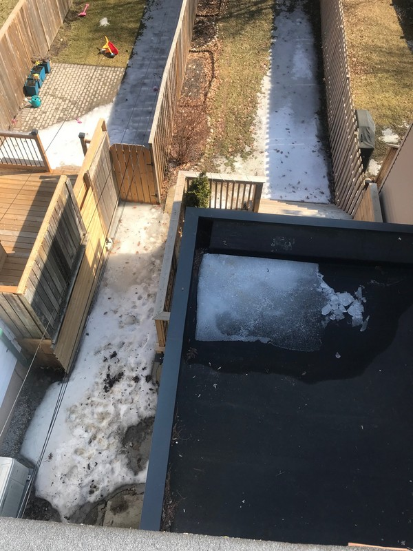 Unique scupper detail on residential flat roof on home in Toronto