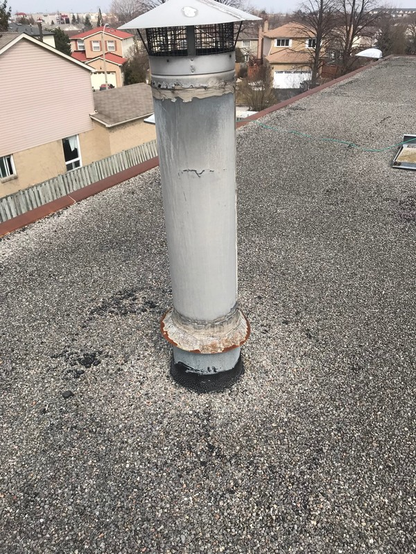 Flat roof repair around vent stack on commercial roof in Ajax