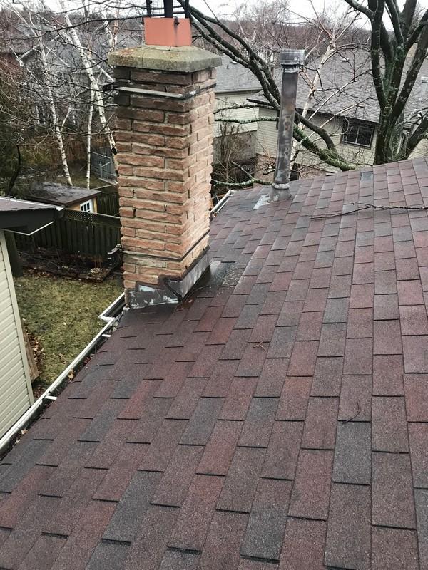 Sealing chimney flashing on shingle roof repair in Pickering