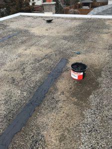 Flat roof repair using plastic cement and Fiberglass mesh on home in Scarborough