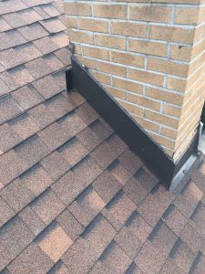Metal chimney cloak flashing with mono sealant on roof in Scarborough