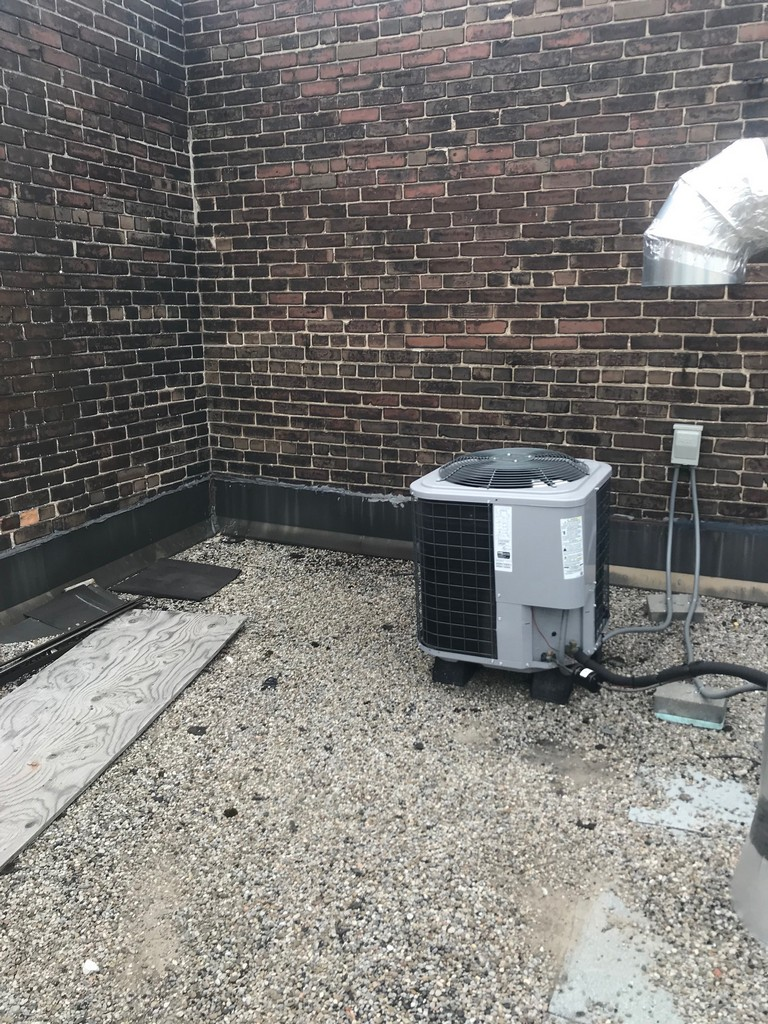 Strategic repairs around split unit on commercial roof in Toronto