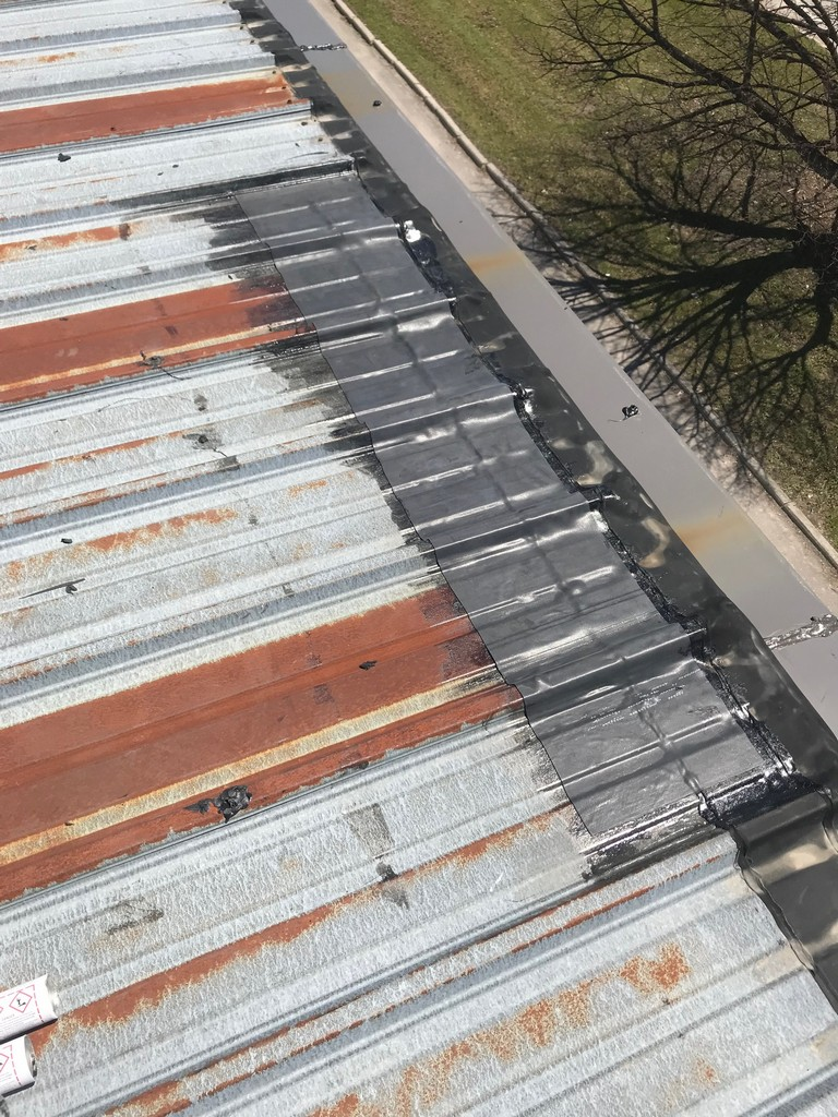 EPDM membranes repairs to flat roof on commercial building in Ajax